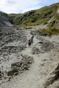 People trekking on Pinatubo