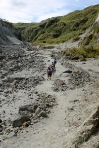 People trekking on Pinatubo
